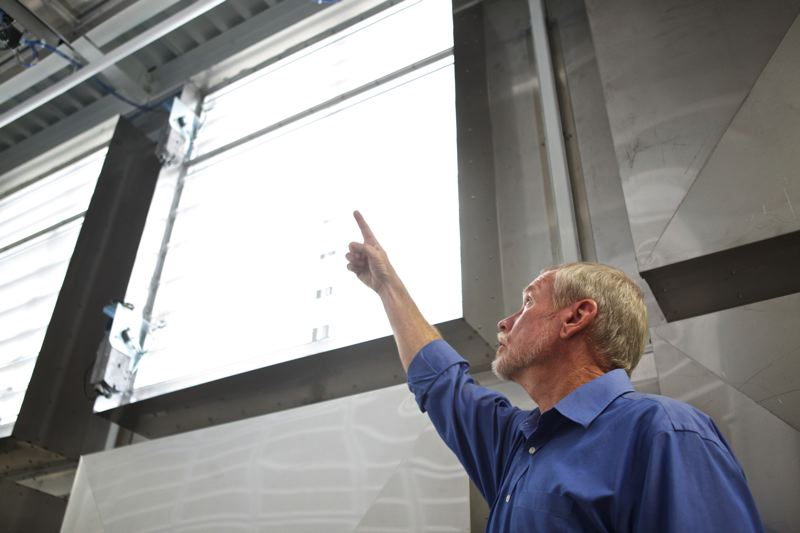 Photo Credit: TIMES PHOTO: JAIME VALDEZ - Perry Gliessman points out vents that allow ambient air to cool the inside OHSU's new Data Center West in Aloha.