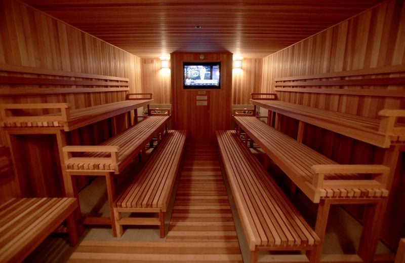 Photo Credit: TIMES PHOTO: JONATHAN HOUSE - The spacious sauna in the men's locker room at VillaSport Athletic Club and Spa features three decks on either side and a flat-screen TV. The women's locker room has one just like it.