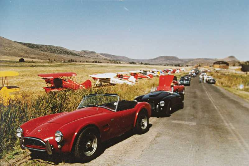 Photo Credit: SUBMITTED PHOTO - One year, 93 sports cars arrived during the fly-in at the ranch and lined up next to them.