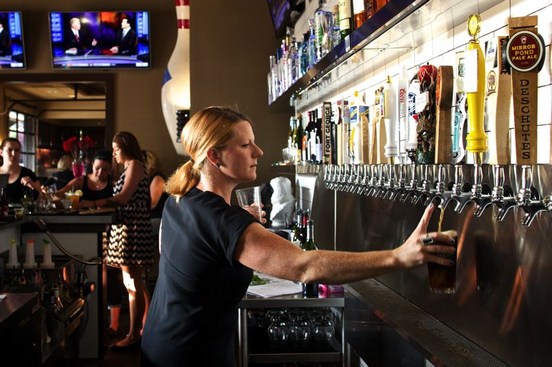 Photo Credit: TIMES PHOTO: JAIME VALDEZ - Bartender Jessica Holmes pours a glass of beer for a customer during the soft opening at the Bethany Public House.