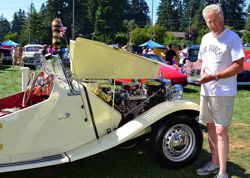 Photo Credit: SUBMITTED PHOTO: OSWEGO HERITAGE COUNCIL - Cam Hatton did everything on his 1952 MG-TD except for the chrome. His effort paid off with the Directors Choice Award at the 2014 Car-Boat Show this past weekend.