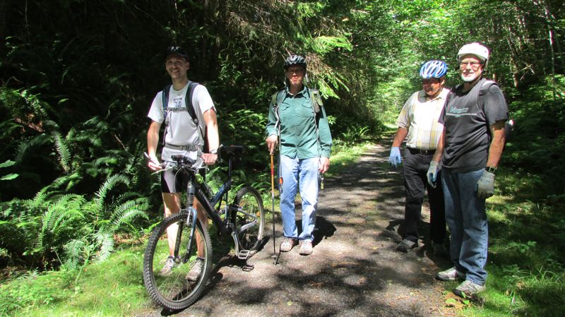 Photo Credit: COURTNEY VAUGHN - A hiking group sets out to explore rugged terrain that could someday be improved to become part of Crown Zellerbach Trail. Left to right: Andy Haugen, Joel Haugen, Larry Lehman and Pete McHugh.