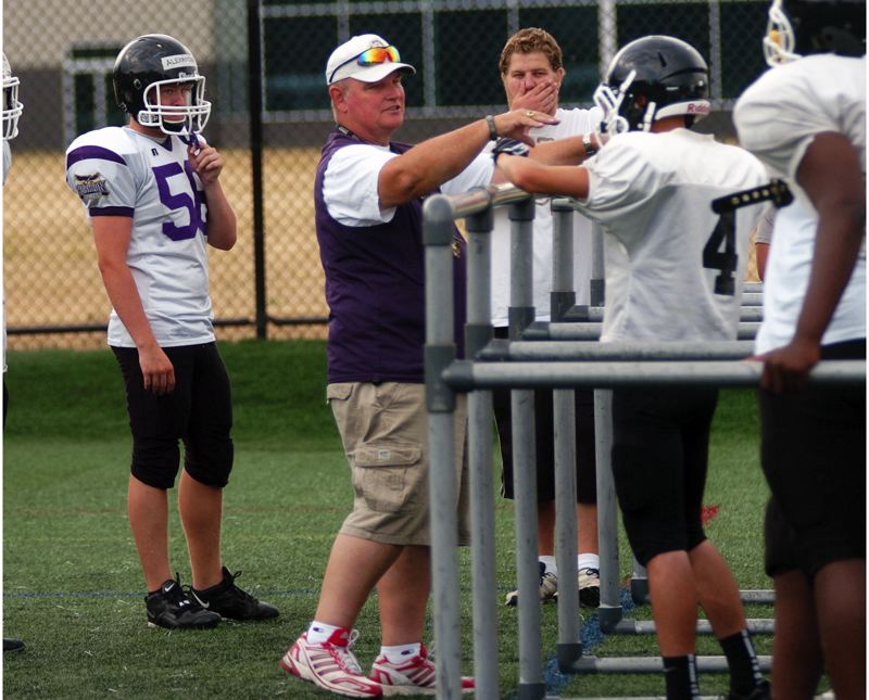 Photo Credit: DAN BROOD - HEAD HAWK -- Horizon Christian High School football coach George Crace gives direction during practice last year. The Horizon Christian program is adding a middle school team this season.