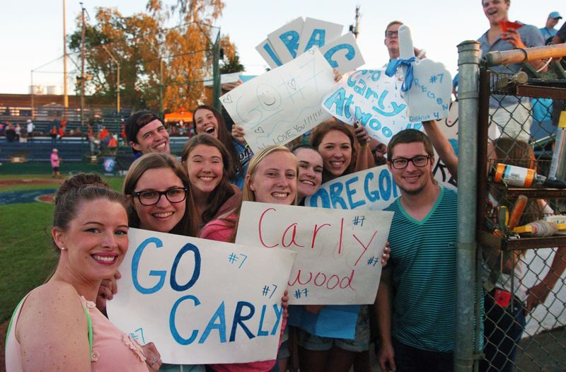 Photo Credit: DAN BROOD - SUPER SUPPORT -- Members of SouthLake Church show their support for the Tigard/Tualatin City Little League softball team, especially outfielder Carly Atwood.