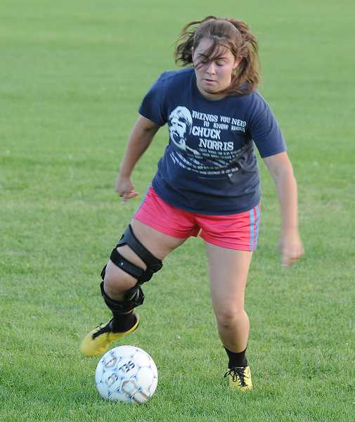 Photo Credit: LON AUSTIN/CENTRAL OREGONIAN - Emily Kreachbaum works on a ball handling drill during practice. Kreachbaum is one of the Cowgirls most experienced soccer players.