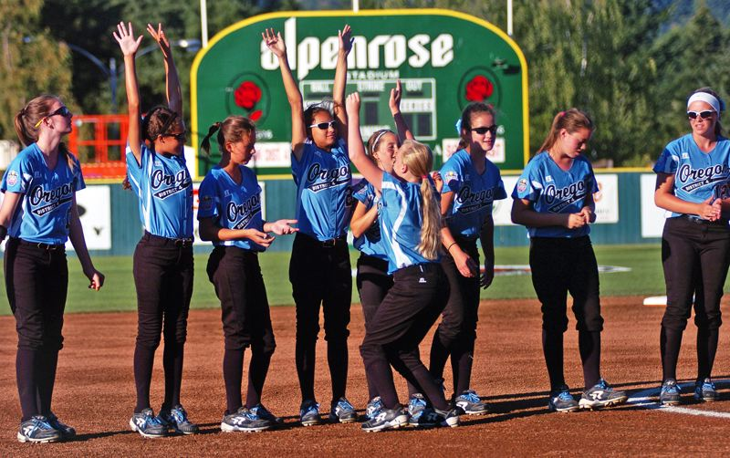 Photo Credit: DAN BROOD - The Tigard/Tualatin City Little League all-star softball team goes through introductions prior to its World Series game against Georgia.