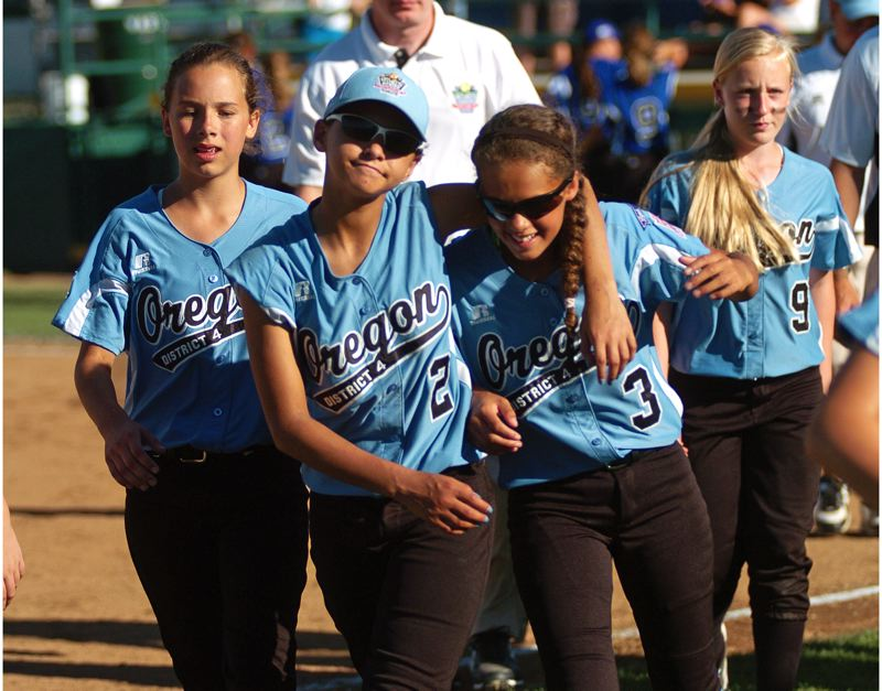Photo Credit: DAN BROOD - Tigard/Tualatin City's (from left) Carly Atwood, Kendra Zuckerman, Tia Cordts and Nicole Box walk off the field following the win over Prague at the Little League Softball World Series.