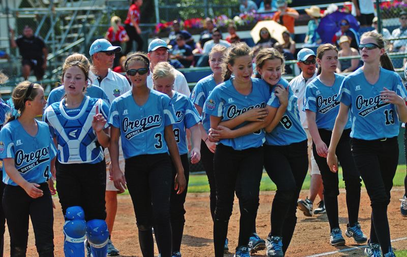 Photo Credit: DAN BROOD - The Tigard/Tualatin City team heads off the field following its victory over Puerto Rico at the Little League Softball World Series.