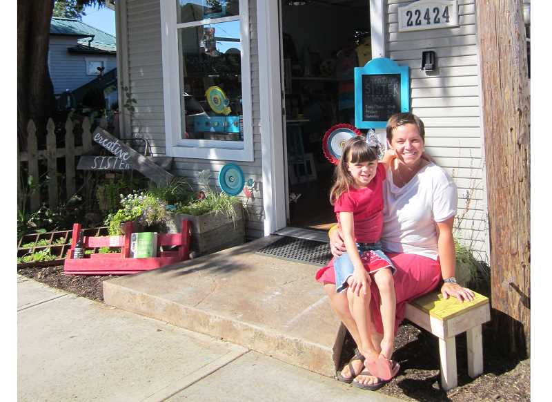 Photo Credit: GAZETTE PHOTO: BARBARA SHERMAN - Wendy Malcomson and her daughter Madilyn sit in front of Malcomson's newest venture, Creative Sister, which is now open in Old Town Sherwood selling upcycled and vintage items.