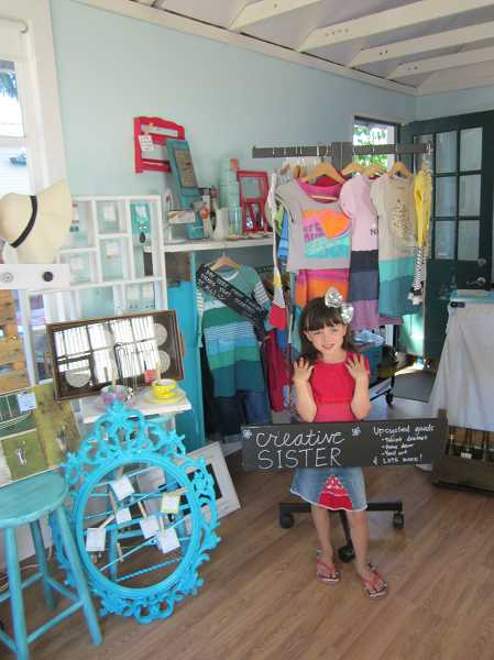 Photo Credit: GAZETTE PHOTO: BARBARA SHERMAN - Madilyn Malcomson stands in her mom Wendy's new shop, Creative Sister, which is filled to overflowing with all kinds of unusual items that Wendy has put together or repurposed for sale.