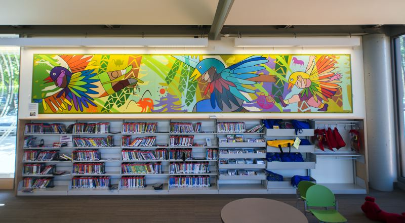 Photo Credit: HILLSBORO TRIBUNE PHOTO: CHASE ALLGOOD - A colorful new mural from Portlands Angelina Marino-Heidel was unveiled last Saturday at the Hillsboro Public Librarys Shute Park Branch.
