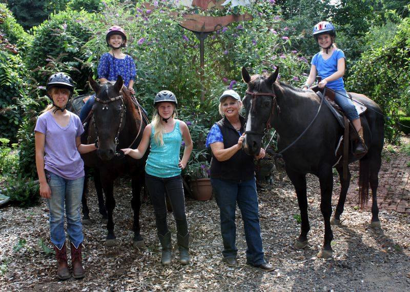 Photo Credit: POST PHOTO: KYLIE WRAY - From left, Makayla Stoker, Audrey Gale, Emily York, Iris White and Macy Maul pose with Blue and Sammy after a lesson.