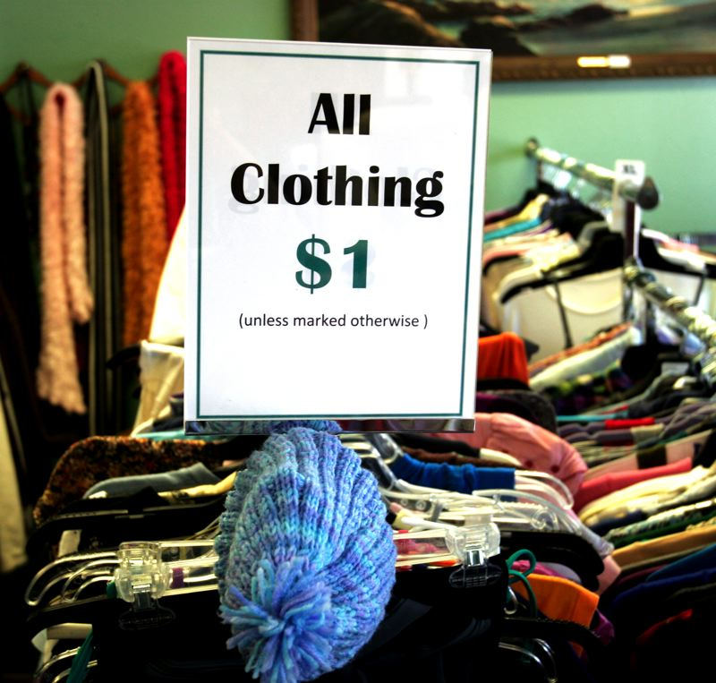 Photo Credit: OUTLOOK PHOTO: JIM CLARK - Yes, all clothing is $1. The Farmers purchase clothing from estate sales and others in bulk quantity, often donating the excess to local hospitals and homeless shelters.
