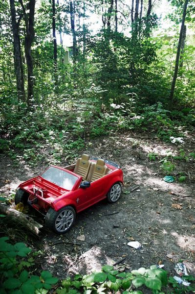 Photo Credit: OUTLOOK PHOTO: JIM CLARK - A broken toy car and litter is in a small clearing in Fairview Woods Wetlands Park. Crime and vandalism in the park have become a problem for the city.