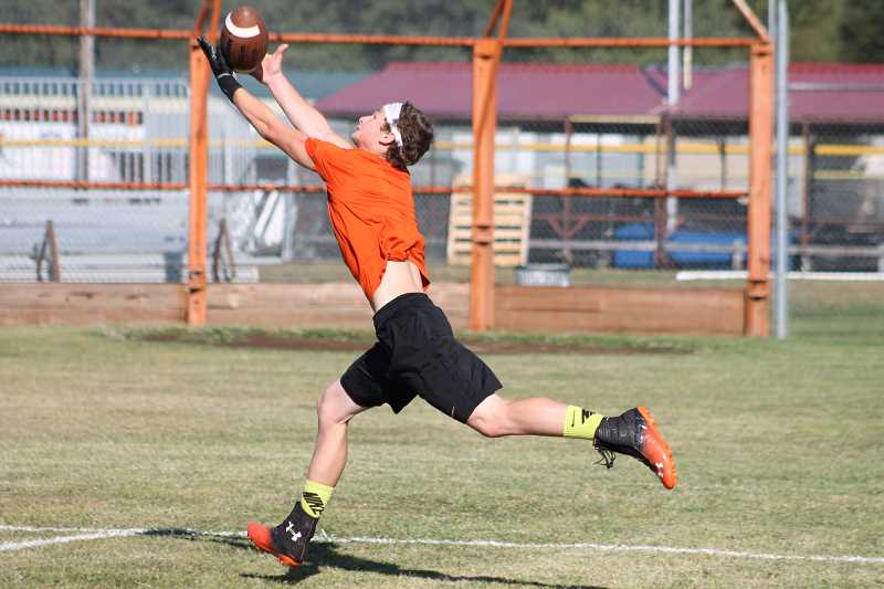 Photo Credit: JIM BESEDA/MOLALLA PIONEER - Molalla junior wide receiver Austin Salley has a reputation as a sure-handed receiver.