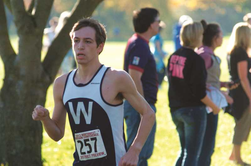 Photo Credit: SPOKESMAN FILE PHOTO - Josh Meyer running during the 2013 district meet.