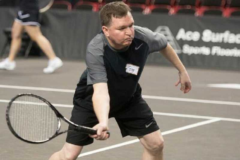 Photo Credit: SUBMITTED PHOTO - Tom Hilts getting ready to hit a forehand volley at the Moda Center.