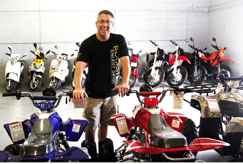 Photo Credit: OUTLOOK PHOTO: JIM CLARK - Nate DeRoss opened Gresham Powersports last spring after a year of selling parts and pre-owned bikes and ATVs by appointment only. The 39-year-old Troutdale resident says the variety of people he encounters each day make the job exciting.