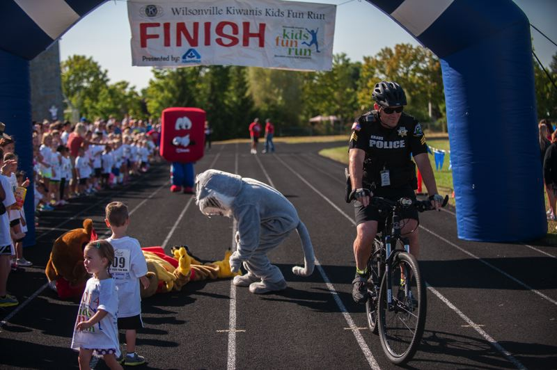 Photo Credit: SPOKESMAN PHOTO: JOSH KULLA - Sgt. Dan Kraus took to his patrol bike for the Wilsonville Kids Fun Run in July, where he participated in, and won, the mascot race.