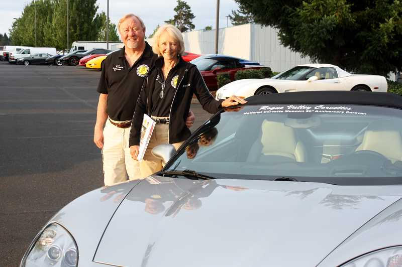 Photo Credit: POST PHOTO: LAURA KNUDSON  - John and Sharon Warren stand next to their 2006 C6 Corvette convertible before hitting the road to Kentucky.
