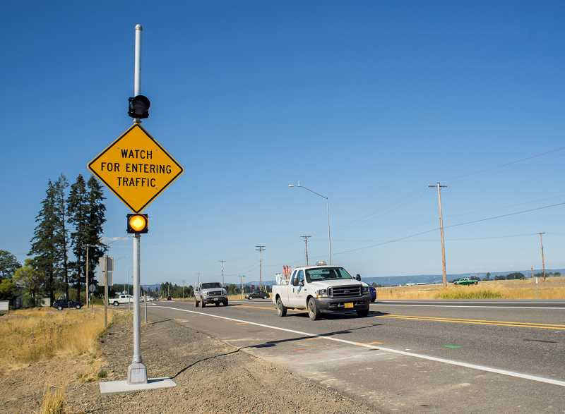 Photo Credit: NEWS-TIMES PHOTO: CHASE ALLGOOD - The Through-Route Activated Warning Signs on Highway 47 are the first ever used in Oregon, according to Lou Torres, spokesman for the Oregon Department of Transportation, and will help alert highway drivers to cross-traffic at Verboort/Purdin roads.