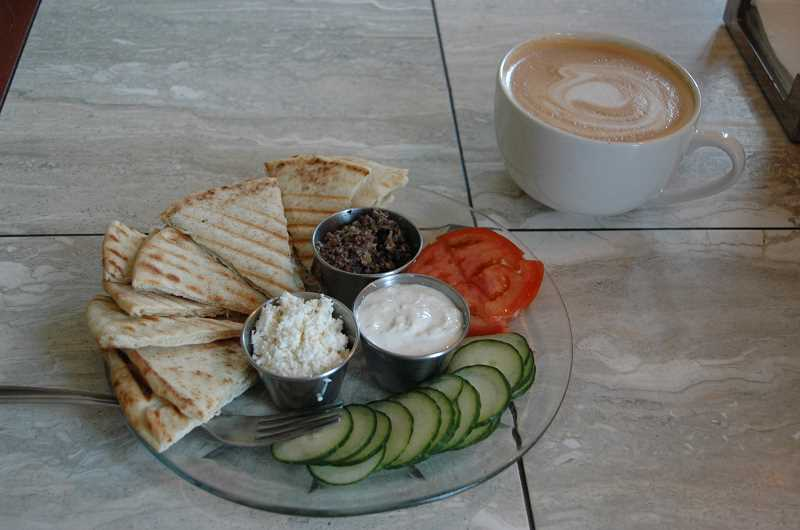 Photo Credit: ESTACADA NEWS PHOTO: ISABEL GAUTSCHI - Vegetarians rejoice! The Grind's pita plate is one of the yummiest meat-free options in Estacada. And that vanilla latte ain't bad either.