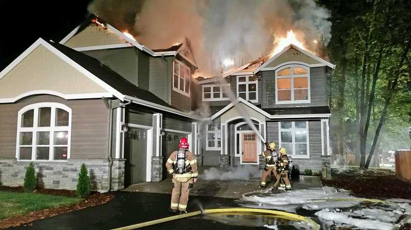 Photo Credit: SUBMITTED PHOTO: TUALATIN VALLEY FIRE & RESCUE - The fire was controlled within 20 minutes after TVFR arrived, but the home was still heavily damaged.