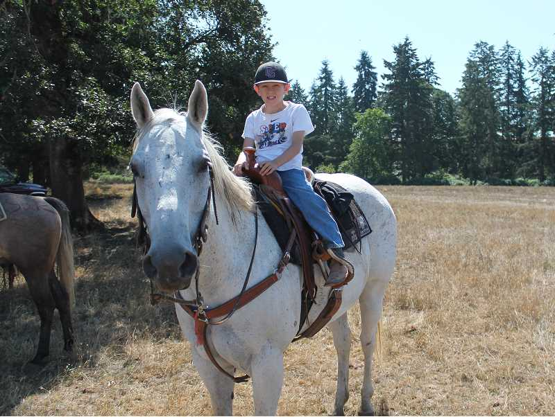Photo Credit: JIM BESEDA/MOLALLA PIONEER - Cade Wynn served as trail boss, assisted by ranch hands Jason McCall and Simon Taylor, during Saturday's Coleman Ranch Ride -- a benefit for the Rider Relief Fund, providing financial assistance to athletes, bull riders and bullfighters who get injured in the sport of bull riding.
