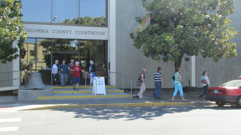 Photo Credit: COURTNEY VAUGHN - People file out of the Columbia County Courthouse Wednesday morning after an evacuation was ordered, following a bomb threat. The building was cleared and access was reopened within an hour.