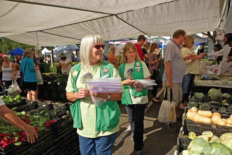 Photo Credit: TIMES PHOTO: JAIME VALDEZ - Ginger Rapport and Sue Poff are the driving forces behind the Beaverton Farmers Market. When Rapport landed the market master job 19 years ago, she was the only employee.
