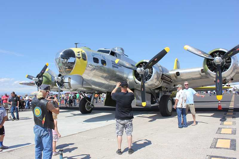 Photo Credit: FILE PHOTO - The B-17 known as 'Chuckie,' which appeared at last year's air show, was purchased by Jack Erickson and renamed the 'Madras Maiden' and now has a new logo painted on its side.