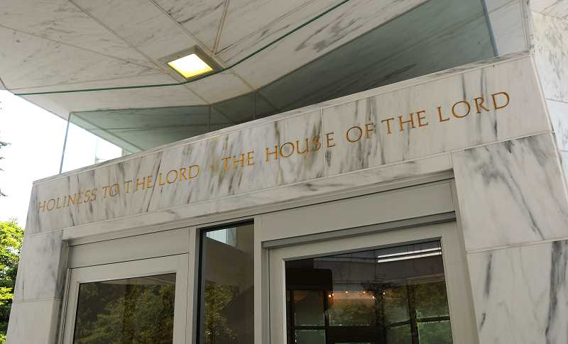 Photo Credit: REVIEW PHOTOS: VERN UYETAKE  - The words over the front entrance sum up the mission of the Latter Day Saints in Oregon.