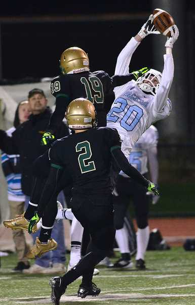 Joe Sindlinger hauls in a pass over two Jesuit defenders in the Pacers quarterfinal loss. Lakeridge was called for more than 200 yards in penalties, and tempers flared on both sides in the second half.