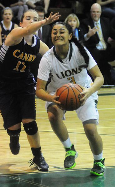 Photo Credit: MATTHEW SHERMAN - West Linn point guard Caitlin Malvar played on the Oregon Elite team this year under coach Gary Lavender. The team went 26-4 and won a pair of out-of-state tournaments.