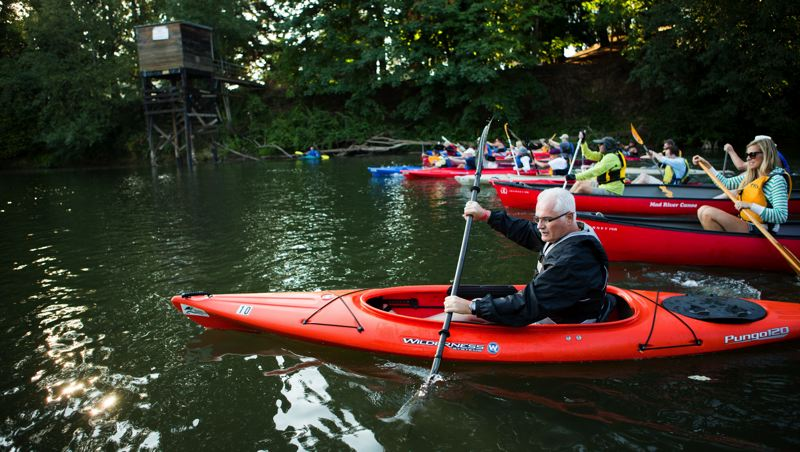 Photo Credit: TIMES PHOTO: DAVID BLAIR - Former Tigard mayor and Metro Councilor Craig Dirksen leads the racers in the Tualatin River Political Paddle Race on Saturday.