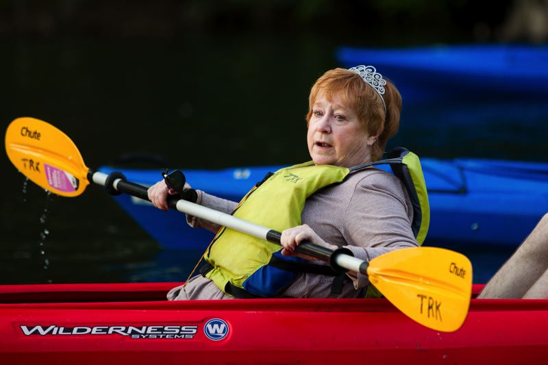 Photo Credit: TIMES PHOTO: DAVID BLAIR - State Rep. Margaret Doherty (D-Tigard) paddles her kayak toward the finish.