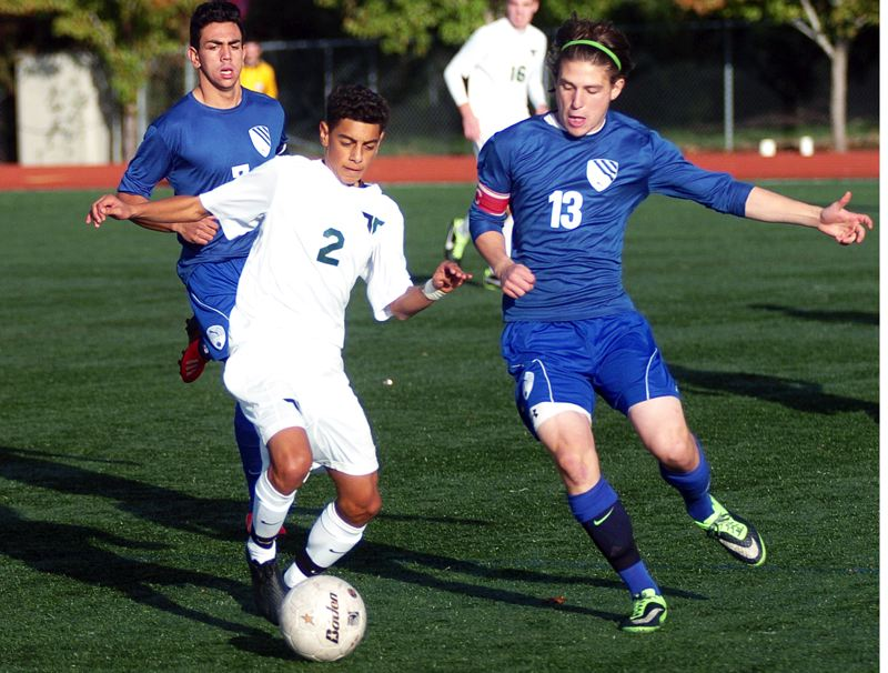 Photo Credit: DAN BROOD - BACK AT TIGARD -- Cesar Contreras (2), shown here in a state playoff match from last year, is one of the key returnees for the Tigard High School boys soccer team this season.
