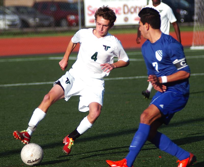 Photo Credit: DAN BROOD - KEEPING CONTROL -- Jake O'Brien (left) is another key returnee for the Tigard boys soccer team this season.