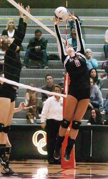 Photo Credit: DAN BROOD - MASTERFUL -- Junior Morgan McMasters returns at setter for the Tualatin High School volleyball team this season.