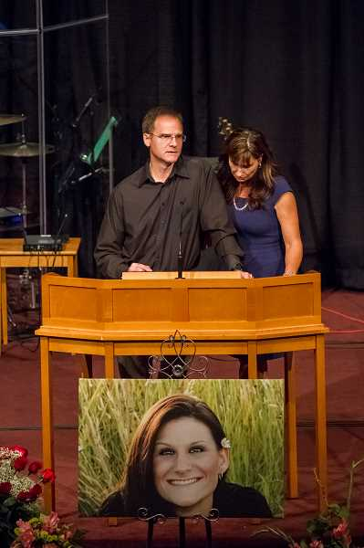 Photo Credit: NEWS-TIMES PHOTO: CHASE ALLGOOD - Rich and Jordi Jones, parents of Nicole Laube, speak during her memorial service held Thursday night at Southwest Bible Church in Beaverton.