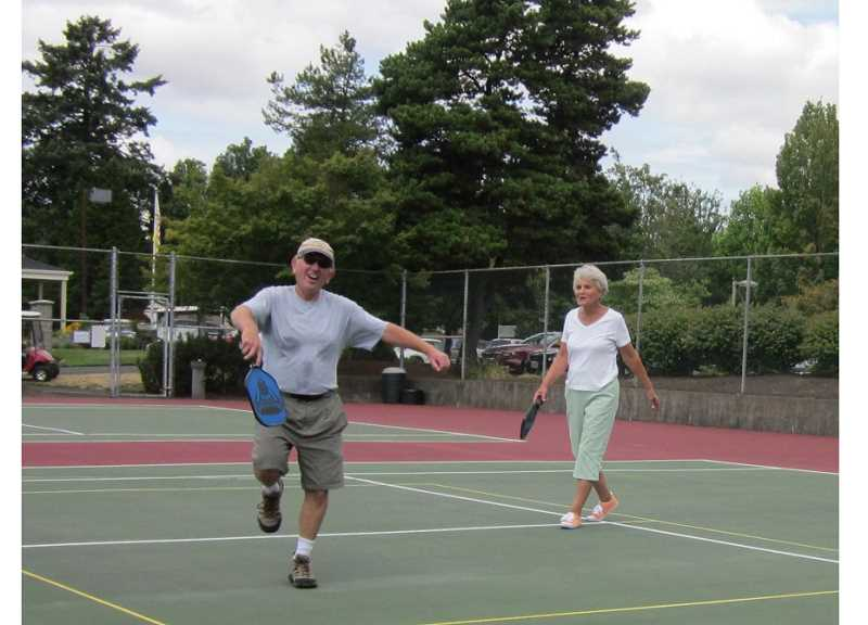 Photo Credit: BARBARA SHERMAN - PLAY (PICKLE) BALL! - There is always time for some laughs and jokes during rounds of pickleball, which gives players some exercise while having fun.