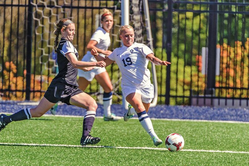 Photo Credit: COURTESY OF CONCORDIA UNIVERSITY - Forward Erin Huisingh (right), a third-team All-American, is among the handful of returning starters from Concordia Universitys 2013 NAIA championship womens soccer team.
