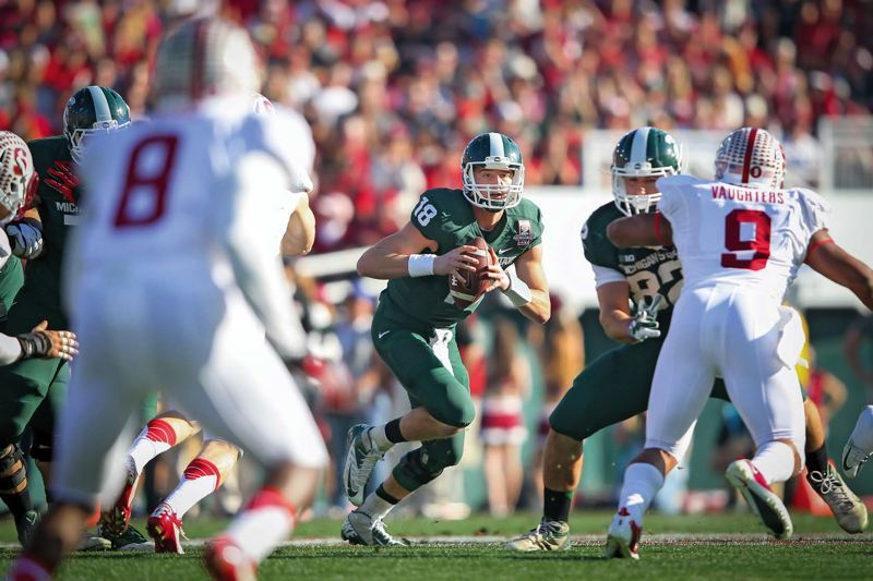 Photo Credit: COURTESY OF MICHIGAN STATE UNIVERSITY - Like Oregon junior quarterback Marcus Mariota, Michigan State junior QB Connor Cook is considered a Heisman Trophy candidate, after going 12-1 in 13 games as a starter last season.