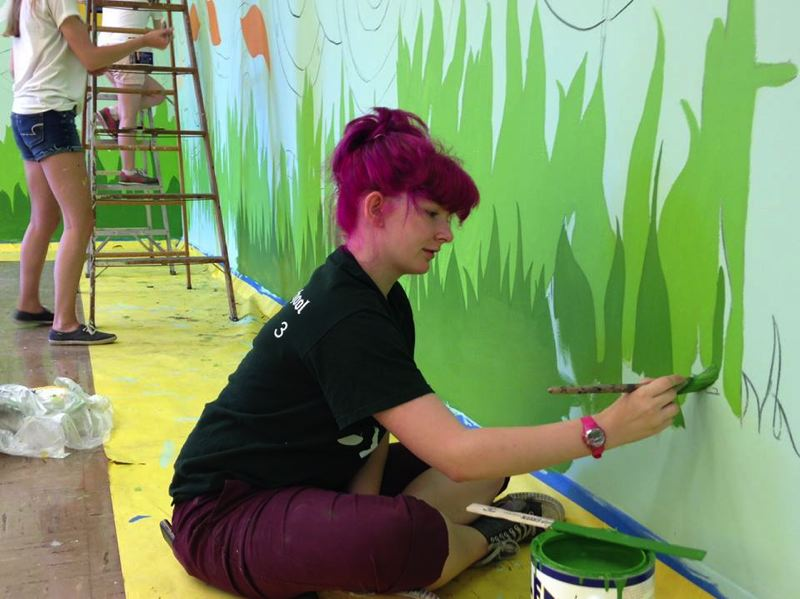 Photo Credit: PHOTO COURTESY OF PORTLAND PUBLIC SCHOOLS VIA FACEBOOK - A student paints a mural celebrating Wilson's new yoga and mindfulness class.
