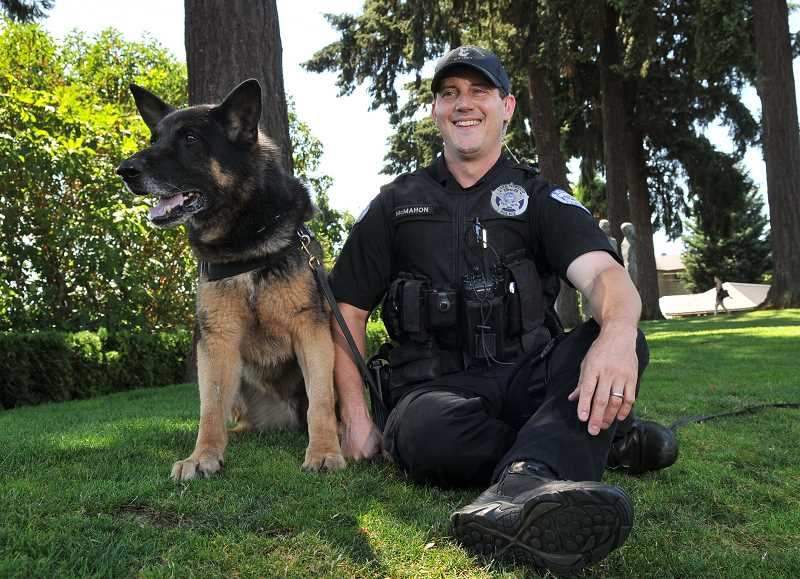 Photo Credit: REVIEW FILE PHOTO: VERN UYETAKE - Officer Bryan McMahon and Kai take a break in the shade during a visit to the Lake Oswego Farmers Market in August.
