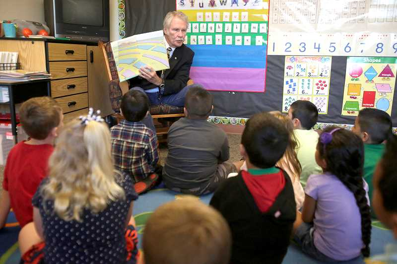 Photo Credit: JONATHAN HOUSE - Oregon Governor John Kitzhaber reads Dr. Seuss' 'Oh, The Places You'll Go' to Tualatin Elementary School kindergarteners on the first day of school. This is the second time in three years that Kitzhaber has attended a Tigard-Tualatin school on the first day of classes.