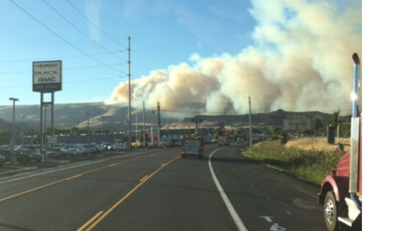 Photo Credit: PHOTO BY: JEFF SMITH - Clackamas County crews arrive in The Dalles near the scene of the Rowena Fire.