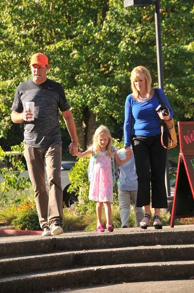 Photo Credit: REVIEW PHOTO: VERN UYETAKE - Katy and Troy Troftgruben walk their daughter, Terra, to school for her first day of kindergarten at Hallinan.