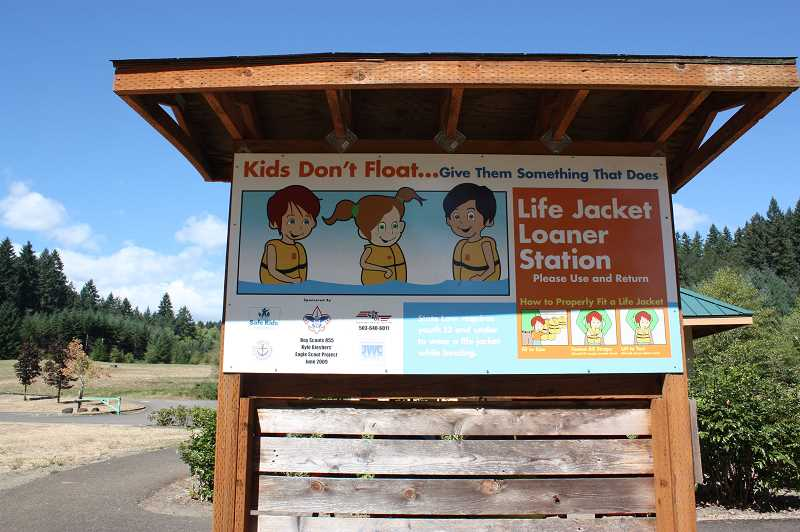 Photo Credit: NEWS-TIMES PHOTO: DOUG BURKHARDT - A kiosk with free loaner life jackets was installed by an Eagle Scout in 2009 at the beautiful but dangerous Sain Creek Picnic Area. Many people, however, dont seem to understand why they might need a life jacket if they are just wading, not swimming.