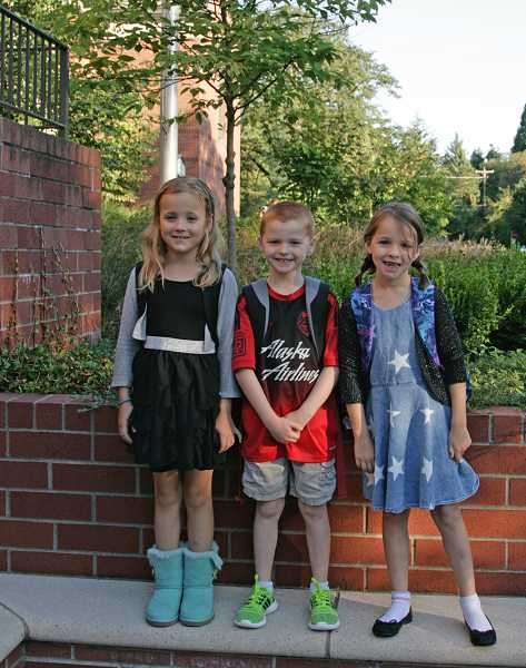 Photo Credit: SUBMITTED PHOTO: MARTIN DIXON -  iverdale Grade School students, from left, Chloe, William and Abigail Dixon pose in their first-day outfits.